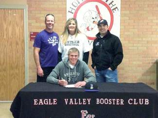 EAgle Valley High School senior Travis Edgar will be wearing purple, gold and black next fall when he becomes a Butler Community College Grizzly. On Monday Edgar, shown here with his parents Bill and Eliza Edgar and EVHS baseball coach Jesse Meryhew, signed his letter of intent to play for the college's baseball team. The school is located in El Dorado, Kansas. Edgar said that after attending a camp in Wichita, the college expressed interest and that he's very excited for the opportunity to attend Butler. In an interesting twist, EVHS Principal Greg Doan grew up in El Dorado. Meryhew was on-hand to congratulate Edgar and said Butler has a very nice campus. The EVHS coach added that he is extremely excited for the upcoming Devils baseball season.