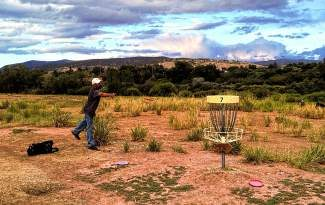 A disc golfer throws for a basket at the Eagle County Fairgrounds course. The course was built in the 1990s and a Discraft Ace Race competition on Oct. 20 will benefit the aging equipment with some upgrades. Registration for the competition is $25 and due Oct. 3.