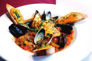Blu's Provencal fish stew with roasted sea bass and mussels in a tomato, red pepper and saffron broth.