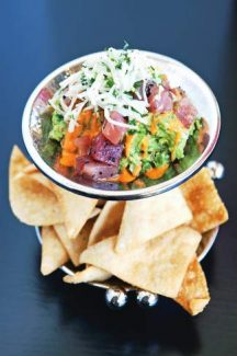 Guacamole prepared tableside and topped with ahi tuna.