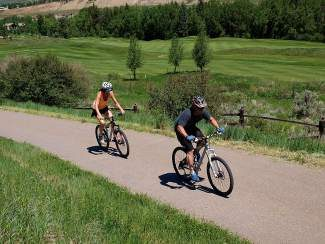 Bike riders enjoy the Eagle Valley Trail along the Arrowhead Golf Course in Edwards. Construction of the final section of trail between Edwards and Eagle-Vail begins this fall.