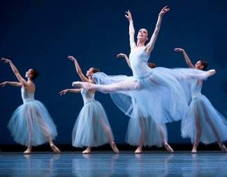 """Sarah Ricard Orza with company dancers in George Balanchine's """"Serenade."""""""