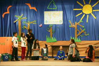 Avon Elementary students perform a skit connected to an Earth Day-themed play for family and other members of the school in Avon on Wednesday.