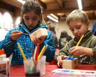 Carla Lorenti, 7, left, and her brother, Brandon, 5, paint little wooden boxes to possibly give as gifts at the Vail Public Library's gift making event for kids in grades K - 5 Tuesday in Lionshead.