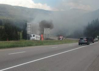 A tractor-trailer rig carrying frozen food on westbound Interstate 70 Thursday afternoon caught fire, engulfing the trailer in flames and temporarily closing the highway in both directions due to heavy smoke. Vail Fire Department Lt. Jim Rabidue said the rig's brakes overheated, sparking a fire in the trailer. The driver was able to stop the rig and separate the truck from the trailer, which was a total loss. Rabidue said there were no injuries, and no fuel spilled from the truck, but westbound traffic was backed up for some time due to the fire.