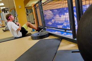 Zach Johnson, of Eagle, does sit-ups at the Gypsum Recreation Center.