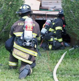 Eagle River Fire Protection District firefighters work to put out a fire at a trailer home in Minturn.
