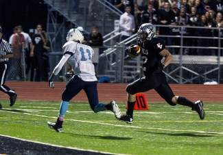 Eagle Valley's Riley Rowles sprints toward the end zone.