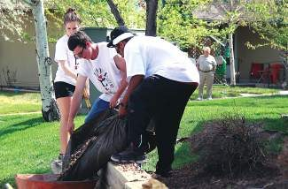 Eagle Valley High School students, from right to left, Xavier Mendoza, Eric Boyd and Laura Claydon help with some landscaping last year at the Golden Eagle Senior Center in Eagle for the Eagle Valley High School Community Service Day.
