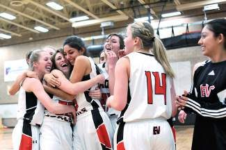 Eagle Valley celebratesafter Megan Asmussen scored the winning 3-pointer at the buzzer in overtime against Rifle in Gypsum on Saturday. The Devils topped the Bears, 62-59.