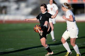 Caption: Eagle Valley's Madison Baxter tries to control the ball Thursday in the Devil's 4-1 loss at Steamboat Springs.