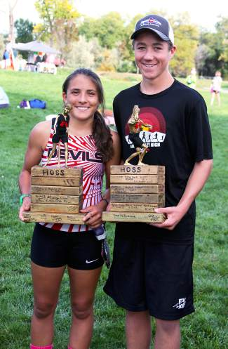 Taylor Hermosillo, left, and Riley Meehan are Eagle Valley cross-country's Hoss Award winners at Friday's meet in Delta.