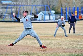 EVHS ace pitcher Travis Edgar fires one in against Summit County during a  Gypsum home game. Edgar threw six perfect innings that day, ending up with a two-hitter as the Devils defeated the Tigers, 6-1.
