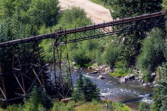 A pipeline crosses the Eagle River carrying contaminated water from the mine near Gilman to be cleaned at the Eagle Mine Wastewater Treatment Facility in Minturn.
