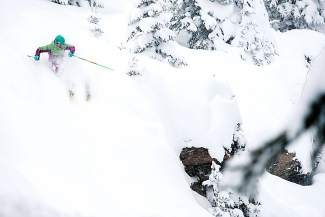 MacKenzie Hanna skis powder on Vail Mountain in January 2014.