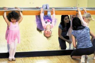 Three-year-old Mia Matteo, left, 2-year-old Anya Anderson, and 2-year-old Calla Rose Silva practice ballet during their Tiny Tots ballet class recently at the Gypsum Recreation Center.