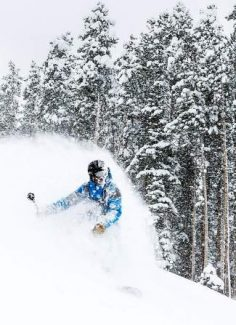 Matthew Timmerman blasts through a powder cloud while enjoying a cold snowy May storm that left the mountains blanketed with snow Monday near Beaver Creek.