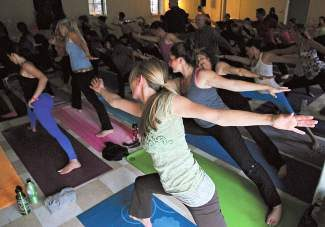 Eagle YogaFest participants stretch into a pose during the festival's Community Yoga Session last year. The Eagle YogaFest returns Oct. 3-5.