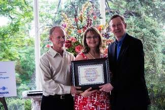 Bart and Mary Kate Ewing celebrate the state safety award presented to Ewing Trucking with Colorado Gov. John Hickenlooper.