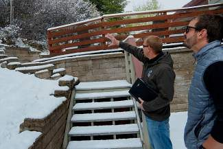"""Eric Lovgren, Wildfire Mitigation Manager for Eagle County, left, discusses with property owner Peyton Bowen on Monday about strategies for protecting his home from the upcoming threat of wildfires. Thanks to a snowy winter and wet spring, wildfire danger this summer is looking to be """"moderate."""""""