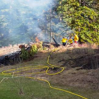 Firefighters work to contain a controlled burn that got out of control on Gypsum Creek Road in Gypsum on Saturday. The fire was one of several that were scattered throughout the valley over the weekend. The fire was contained and no one was injured in  any of the fires.