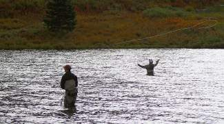 Competitors in the America Cup Fly Fishing tournament cast out their lines into the Black Lake Saturday on Vail Pass on day three of the competition.