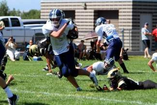 Vail Christian's Cole Caynoski runs through the Rocky Mountain  Lutheran defense Saturday afternoon in Denver during the Saints' 52-18 victory over the Eagles.