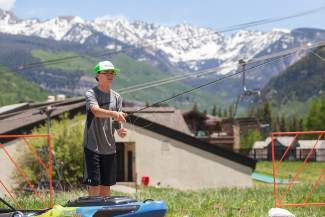 Brody Nielsen, 12, practices fly fishing at the GoPro Mountain Games on Friday in Vail.