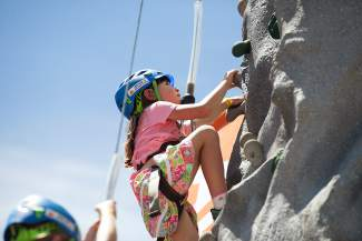 Caroline Harrington of Minturn does some rock climbing at the GoPro Mountain Games In Lions Head Village on Friday June 10th