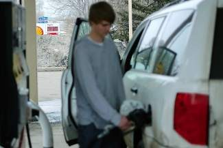 Christian Pellerito, of Avon, pumps gas at a station in Avon where the price for regular fuel was at $3.99/gallon on Thursday. With refineries shutting down, oil companies switching to summer blends, and supply going down, gas prices are on the climb.