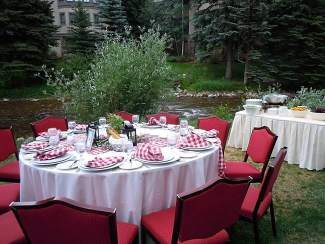 The tables for the Gather in the Garden dinner are set up next to Gore Creek for the best views.