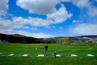 Todd Grant, of Vail, practices at the Gypsum Creek driving range on Tuesday. Local courses are beginning to open up and many golfers have been found braving the recent chilly and wet weather.