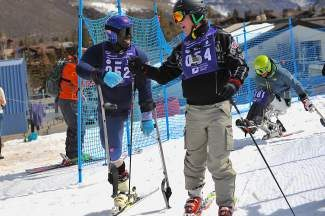 U.S. Disabled Alpine Ski Team member Ralph Green shares a fist pump with Joe Rooney after the skiers competed in the 19th annual Adaptive Spirit fundraiser in Vail on Saturday. Green is a Vail resident and was the top finishing American in alpine skiing's standing slalom and giant slalom disciplines at the Paralympics this year.