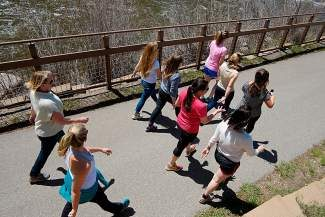 Employees of the Vail Valley Foundation take a 30-minute walk along the Eagle River in Avon during their workday on Monday. The foundation is one of a handful of Eagle County businesses that has instituted a comprehensive health and fitness program for its employees.