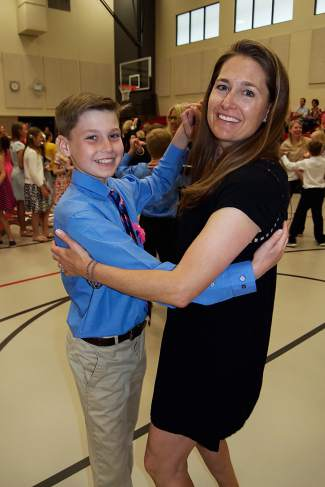 PJ and Tanya Kessenich take part in the parent-child dances during the Eagle County Charter Academy formal on May 26.