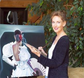 Recently artist Marie Channer has been painting Flamenco dancers, such as the one she's pictured with here.