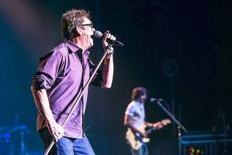 After a 36-year career that includes a string of hits and over 30 million albums sold, Huey Lewis' voice is a bit more raspy but he belts out the band's many hits nonetheless.