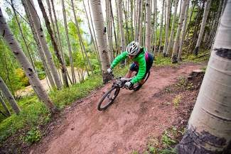 """In this shot from the International Mountain Biking Association's new film """"Crossing the Divide,"""" mountain biker Jennifer Hill rides the trail network in Vail near the confluence of the North Trail and Son of Middle Creek trails."""