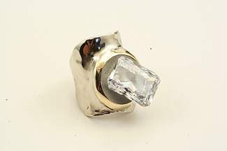 This ring features a 14-karat white and yellow gold wide band with a cubic zirconia set in cement.