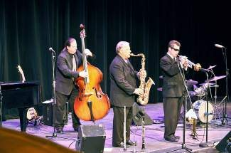 Andy Hall, Roger Neumann and Mike Gurciullo entertain students at the 2013 Jazz Goes to School concert.