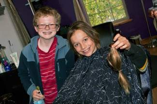 Jensen Rawlings, right, grew his hair since age 8 and cut it off on his 11th birthday Oct. 11 to donate to Locks of Love in honor of his friend Finn Rooney, left, who had Leukemia as a toddler. Rawlings plans to continue growing and donating his hair.