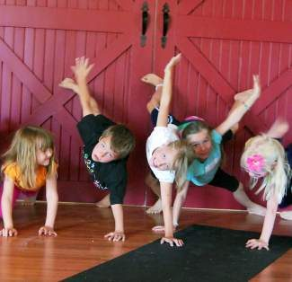Learn how to lead kids yoga classes with this 20-hour kids yoga teacher training program at Yoga Off Broadway in Eagle.