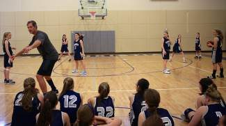 Former standout at Duke and former NBA player, Christian Laettner coaches Vail Christian's girls basketball team during a clinic at the school Friday in Edwards. Tonight, Laettner will be at the school for a fundraiser.