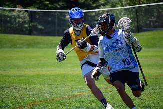 Sam Cofield of Denver dodges a Team Colorado player as he takes the ball to goal on Thursday. Cofield and his team, War Cry, beat Team Colorado by one point to claim 7th in the Vail Lacrosse Tournament.