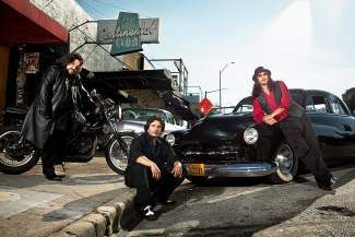 Los Lonely Boys is comprised of the three singing Garza Brothers — drummer Ringo, 6-string bassist Jojo, and guitarist Henry.