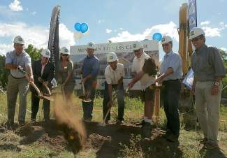 Ski and Snowboard Club Vail Executive Director Aldo Radamus, center right, joins members of the Minturn Town Council and other officials in a groundbreaking ceremony for the new Minturn Fitness Center Monday at Maloit Park in Minturn.