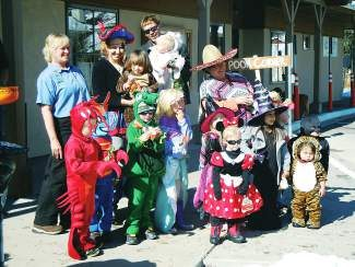 The staff and children from Pooh Corner stopped by Minturn Town Hall to say hello in this 2011 file photo. Minturn's annual trick-or-treat trot is set for tonight from 4 to 8 p.m.