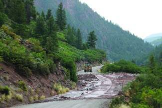 Eagle County crews work to reopen Gypsum Creek Road Tuesday afternoon after a mudslide blocked the road. An Eagle County alert was sent out at 4:30 p.m. advising motorists about the mudslide, which covered the road approximately 7 miles up the Gypsum Creek Valley.