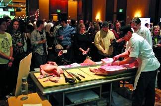 Chef Bill Grenwood of Beano's Cabin butchers a pig in front of an audience of pork fans during Cochon 555, a competition between five chefs that took place at the Four Seasons in Vail in March. Jason Harrison and his crew at Flame won the competition.