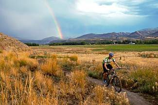 A high school student bikes along the Haymaker trail last fall. The trail is used for the annual Colorado High School Cycling League state championships.